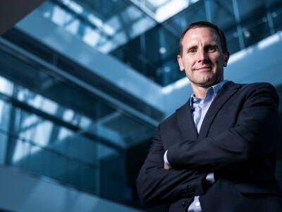 A professional portrait of John Bingham, Donald L. Staheli Professor and associate dean for the BYU Marriott School of Business.