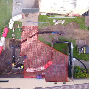 Ariel view of the sidewalk in front of the CAC side entrance to the McKay Gymnasium. The sidewalk immediately in front of the entrance and up to the barricade near the Gym Parking Lot is highlighted as the construction zone.