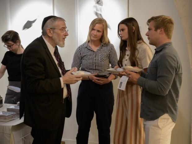 Photo of students talking with a Jewish leader