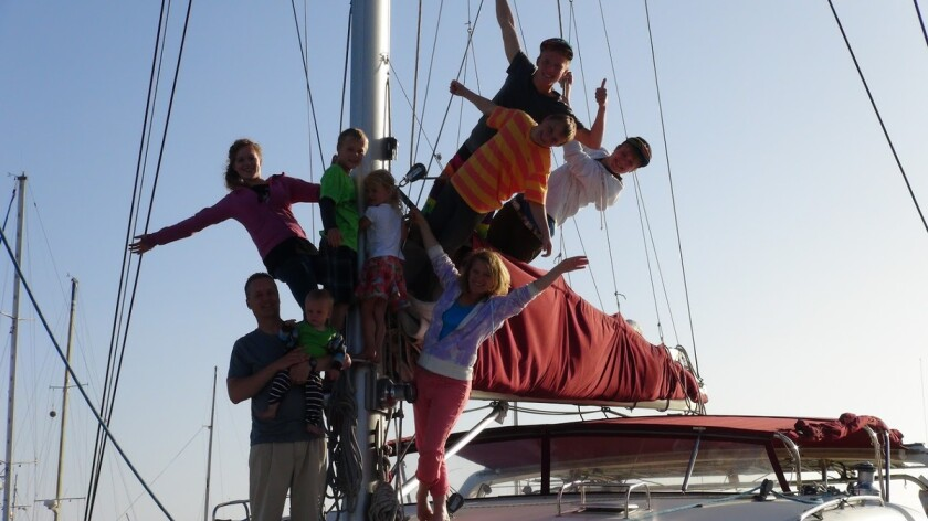 The Schafer Family on board their sailboat.