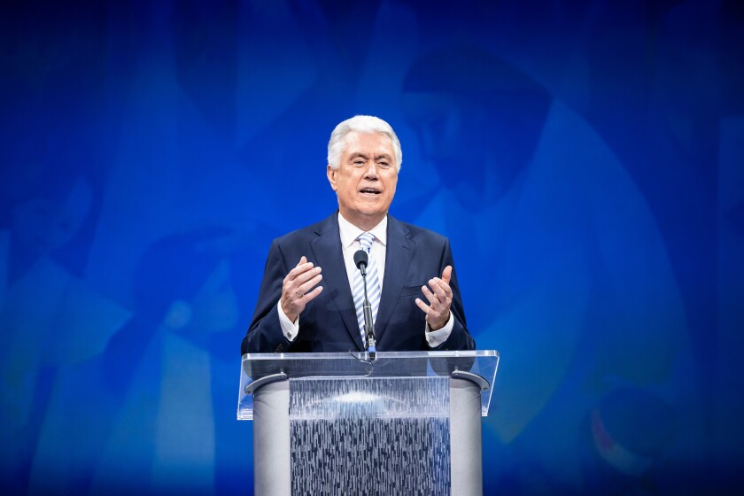 A professional portrait of Elder Dieter F. Uchtdorf, a member of the Quorum of the Twelve Apostles from the Church of Jesus Christ of Latter-day Saints, delivering a devotional address to campus during Education Week 2021.