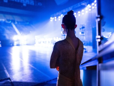 A dancer waits to run on stage