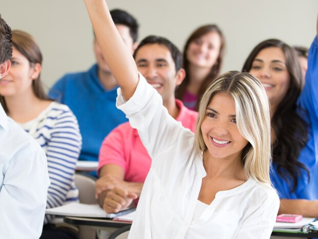 Photo of a female student with her hand raised