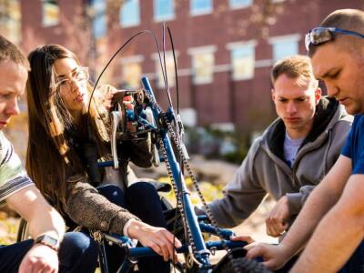 Students working on a prototype of a new bicycle