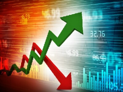 Image of arrows, trendlines, and numbers representing economics.