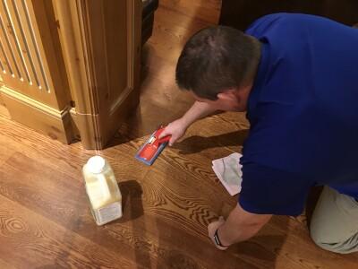 Repairing and polishing hardwood floors.