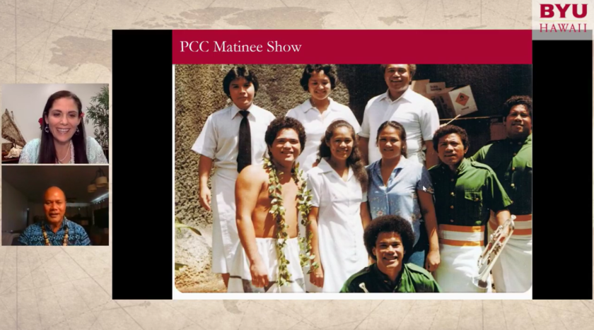 """Screenshot of a video call of Eddie Maiava and Becky Sampson on the with the slide with the words """"PCC Matinee Show"""" and a photo of nine people, one shirtless and a lei around his neck, the others in white outfits or green."""