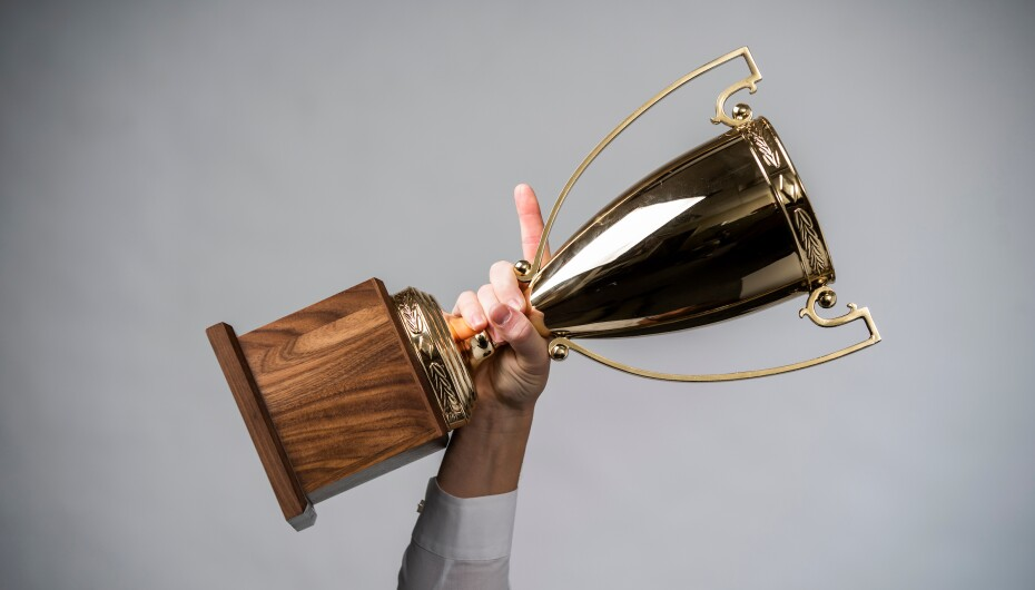 Hand holding a large trophy