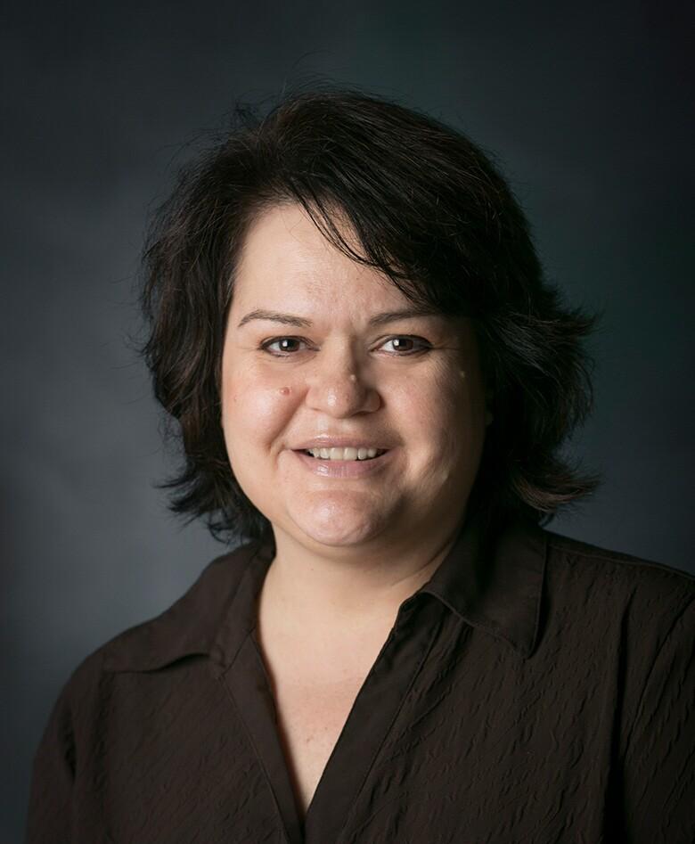 English Professor Anna Christiansen headshot wearing a brown shirt