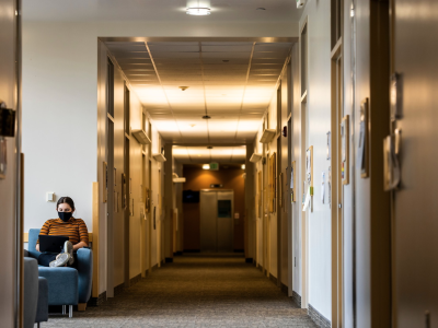 Student sitting in hall