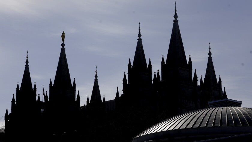 The spires of the Salt Lake Temple and roof of the Tabernacle in Salt Lake City, Utah.