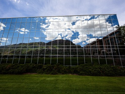 Y Mountain is reflected off the glass of the Conference Center