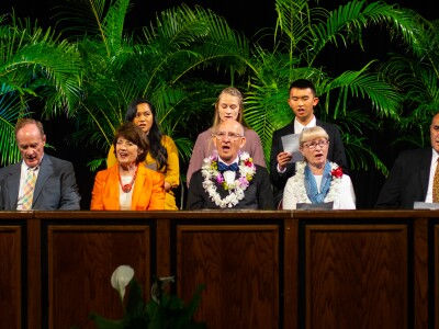 Dr. Neil J. Anderson sits at the stand with his wife, other BYUH faculty and students.