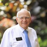 A portrait of Elder Larson smiling at the camera.