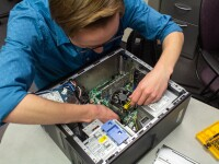 Physical Facilities Information Support repairing a computer.