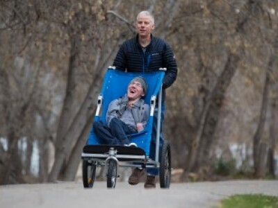 Engineering students build adult-sized bike trailer for professor's son with cerebral palsy