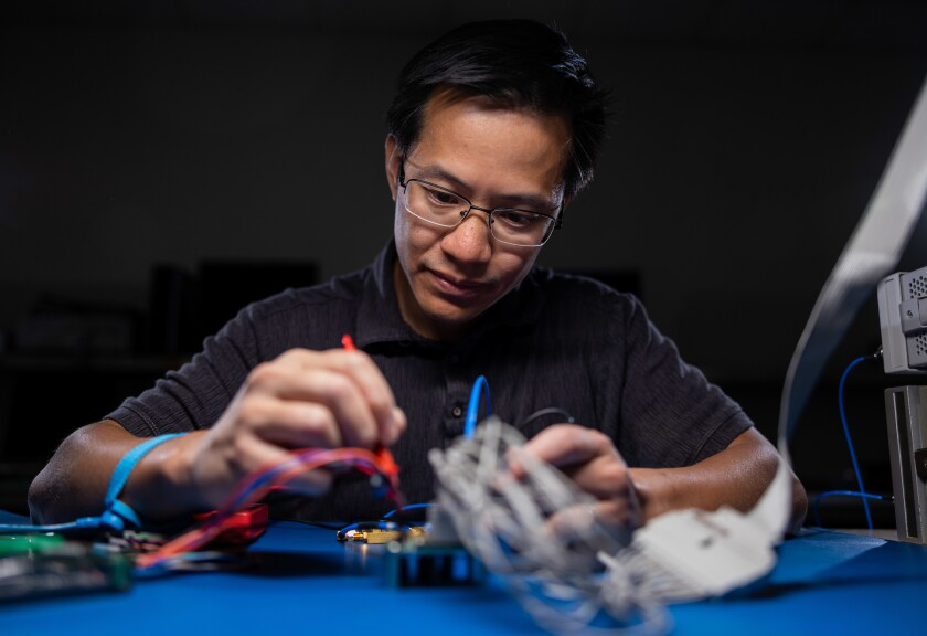 BYU professor Wood Chiang working on an ADC microchip in his lab.