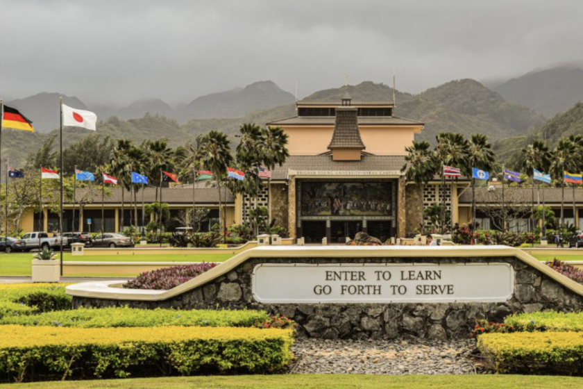 The entrance of BYUH and the Flag Circle on a cloudy day.