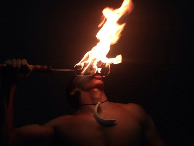 Odgerel Ganbaatar holds a fire torch up to his lips during a performance