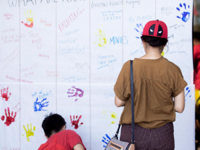 Image of students signing a wall