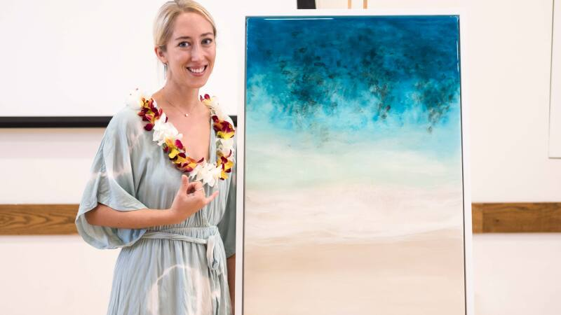 Sarah Caudle with one of her artworks.