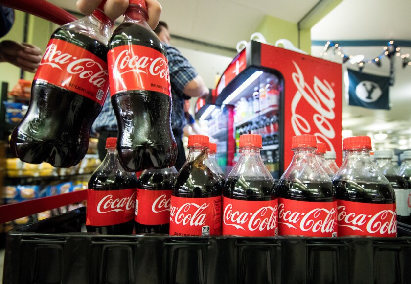 Dining Services employees stock Coca Cola bottles on campus