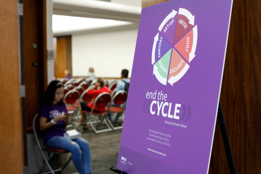 Title IX's End the Cycle campaign graphics on a sign by a door outside an event