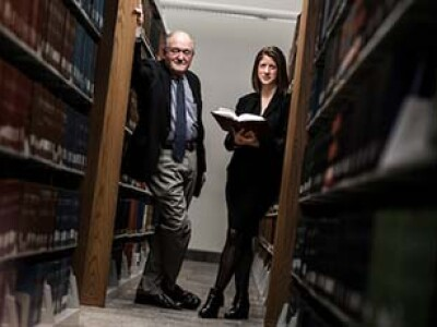 Clifton Fleming and Gladriel Shobe in an aisle of the law library