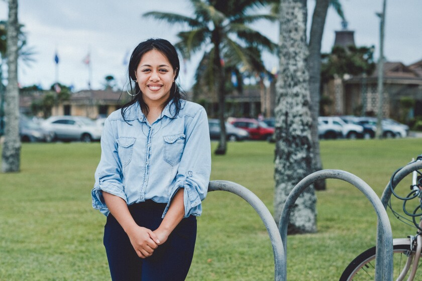 Leilani stands in front of a bike rack on BYU–Hawaii's campus