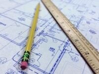 Architecture blueprints with ruler and pencil.