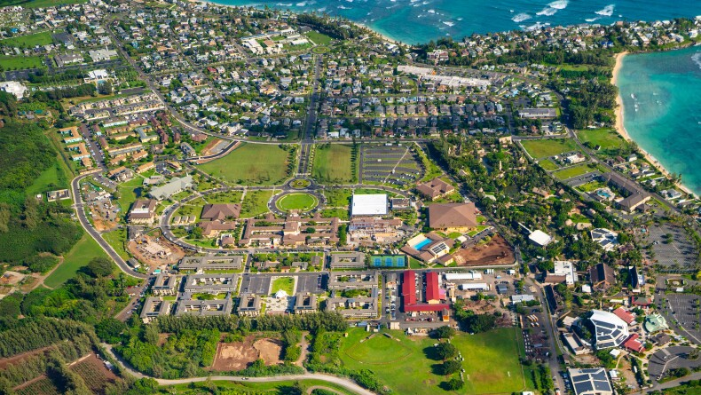 Aerial view of the BYU–Hawaii campus including the Polynesian Cultural Center, town of Laie, and parts of Laie Bay.