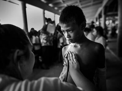 Rheumatic Relief Tina Measures Boy's Heartbeat