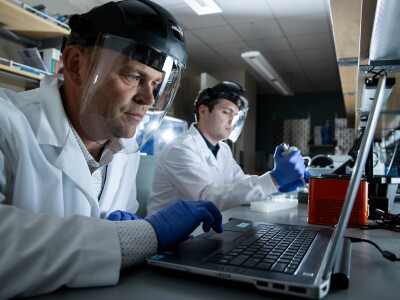 BYU professor and students working in the lab.