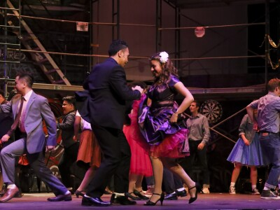 Actors dancing during the West Side Story school play