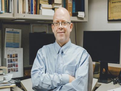 Dr. Matthew L. Bowen sits in his office