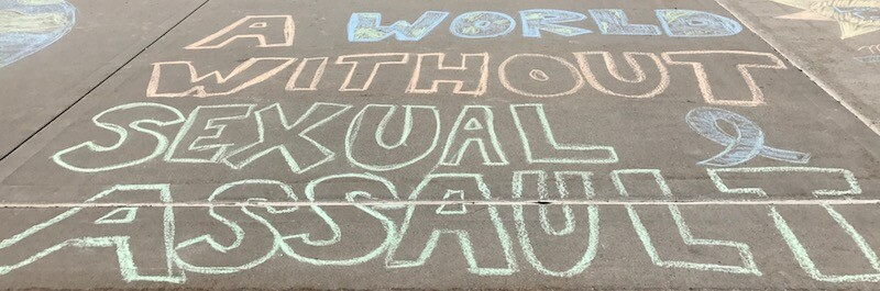 "Photo of sidewalk art spelling out ""A World Without Sexual Assault"""