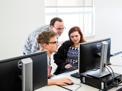 BYU faculty members collaborate at a computer
