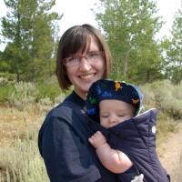 Jessie Crapo holding a baby