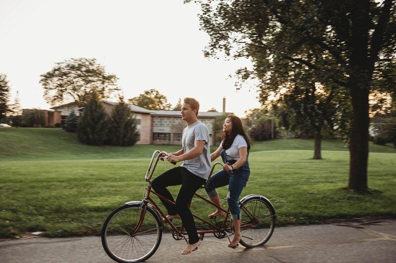 Jacob and his fiancee ride a tandem bike.