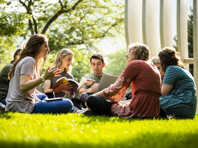 Students talking on the lawn