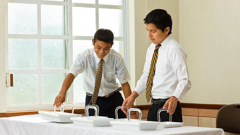 Young Men prepare the sacrament.