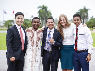 Image of multicultural students standing and smiling