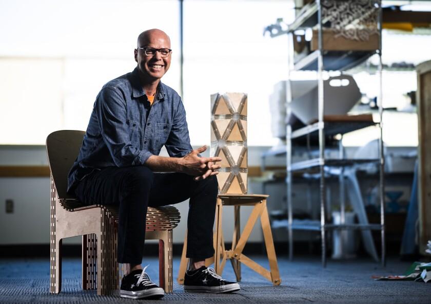 David Morgan, BYU industrial design professor, and his bendable plywood furniture.
