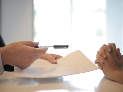 crop-businessman-giving-contract-to-woman-to-sign-3760067.jpg