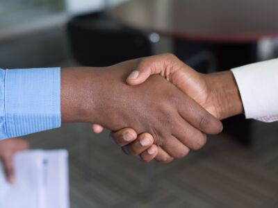 Two people shaking hands.