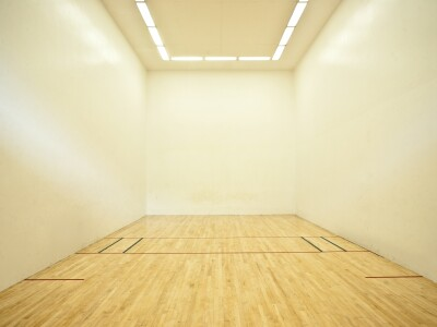 Photo of inside of a racquetball court