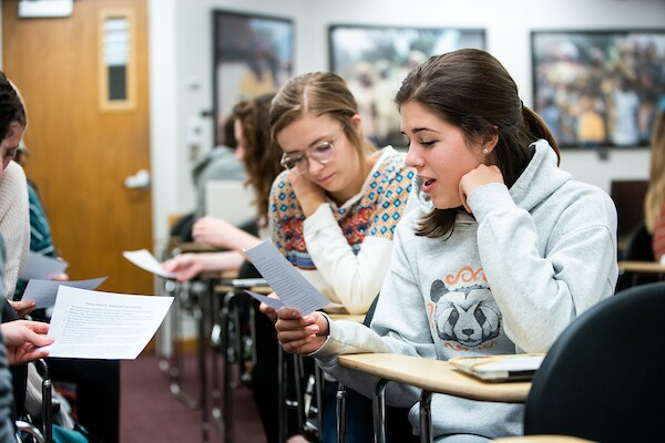 students discuss a reading in the Globa Women's studies class