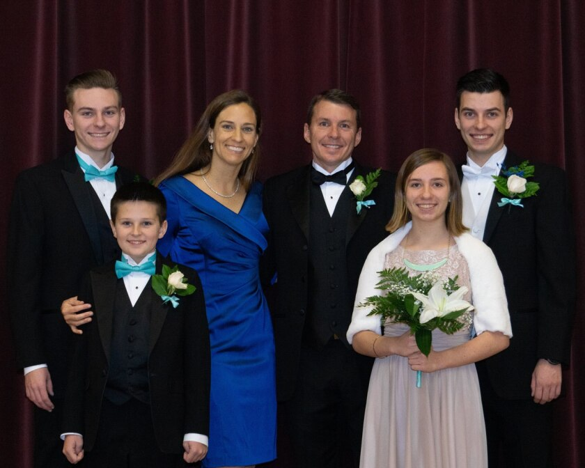 Bret Grow and his family in formal attire.