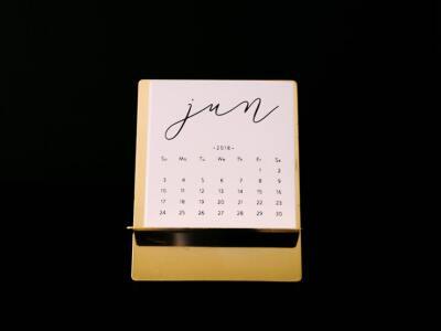 A white June calendar against a black background.