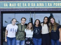 Photo of multicultural students standing and smiling